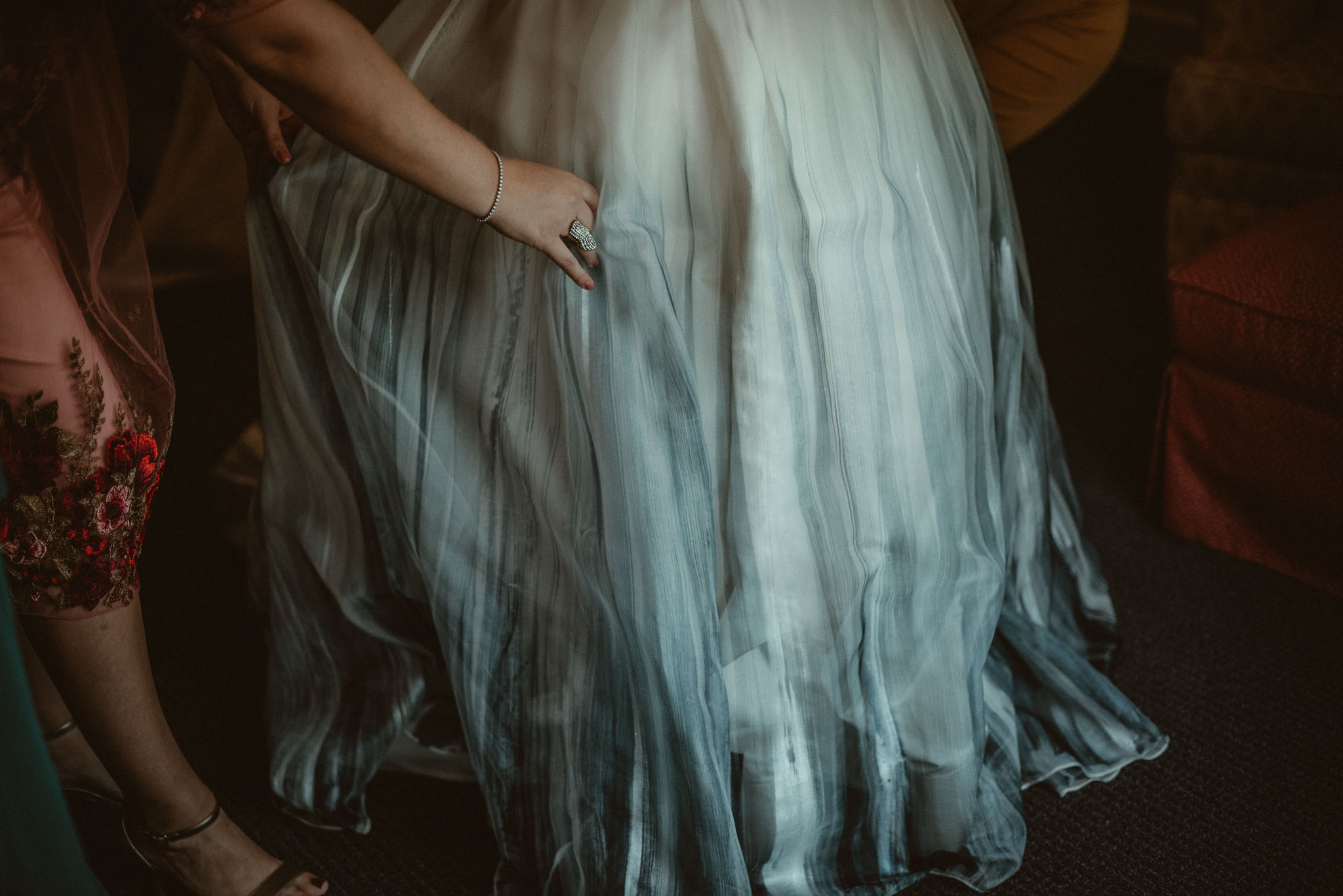 Close up of the brides blue dipped wedding dress skirt