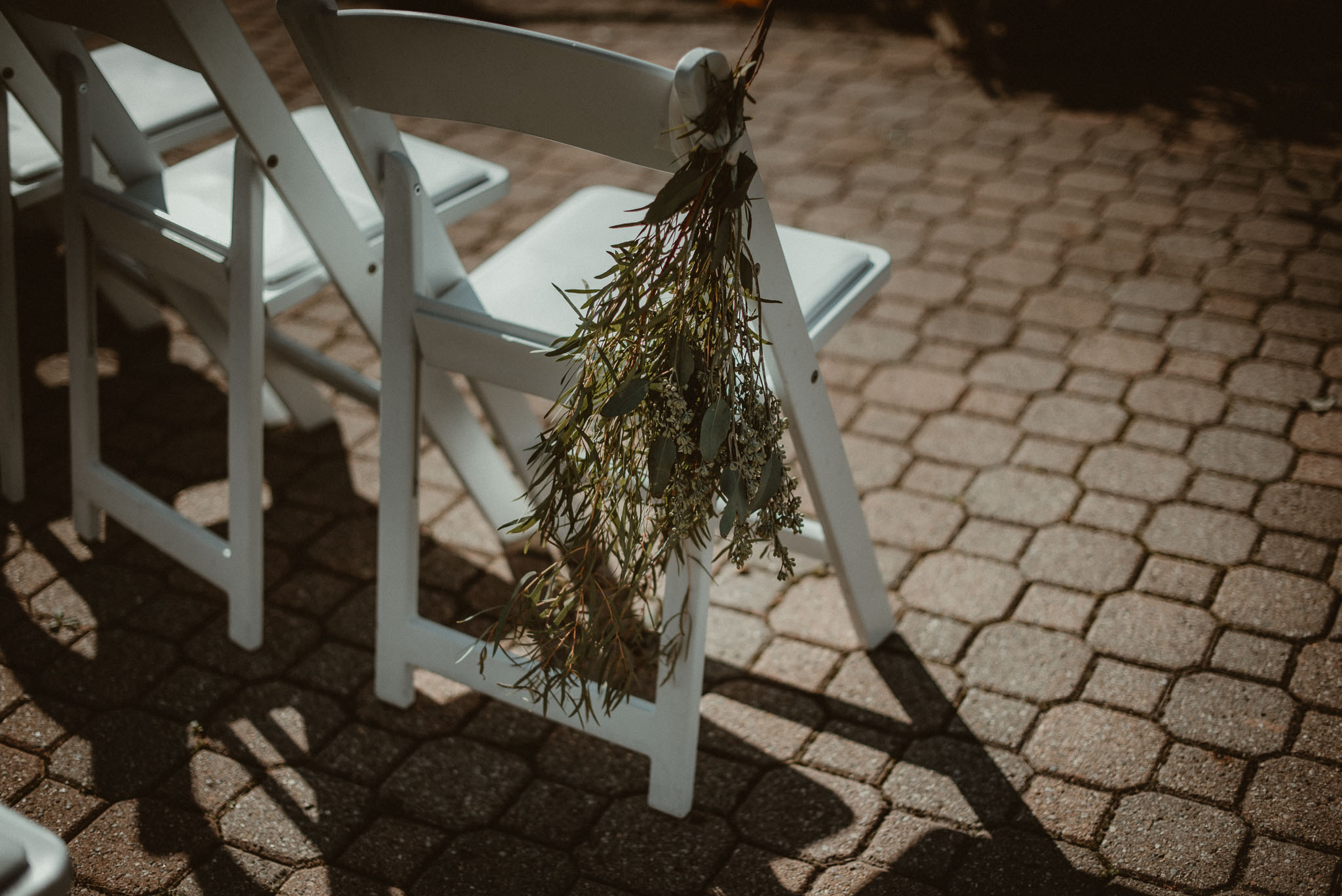 Guest chair with decorative greens