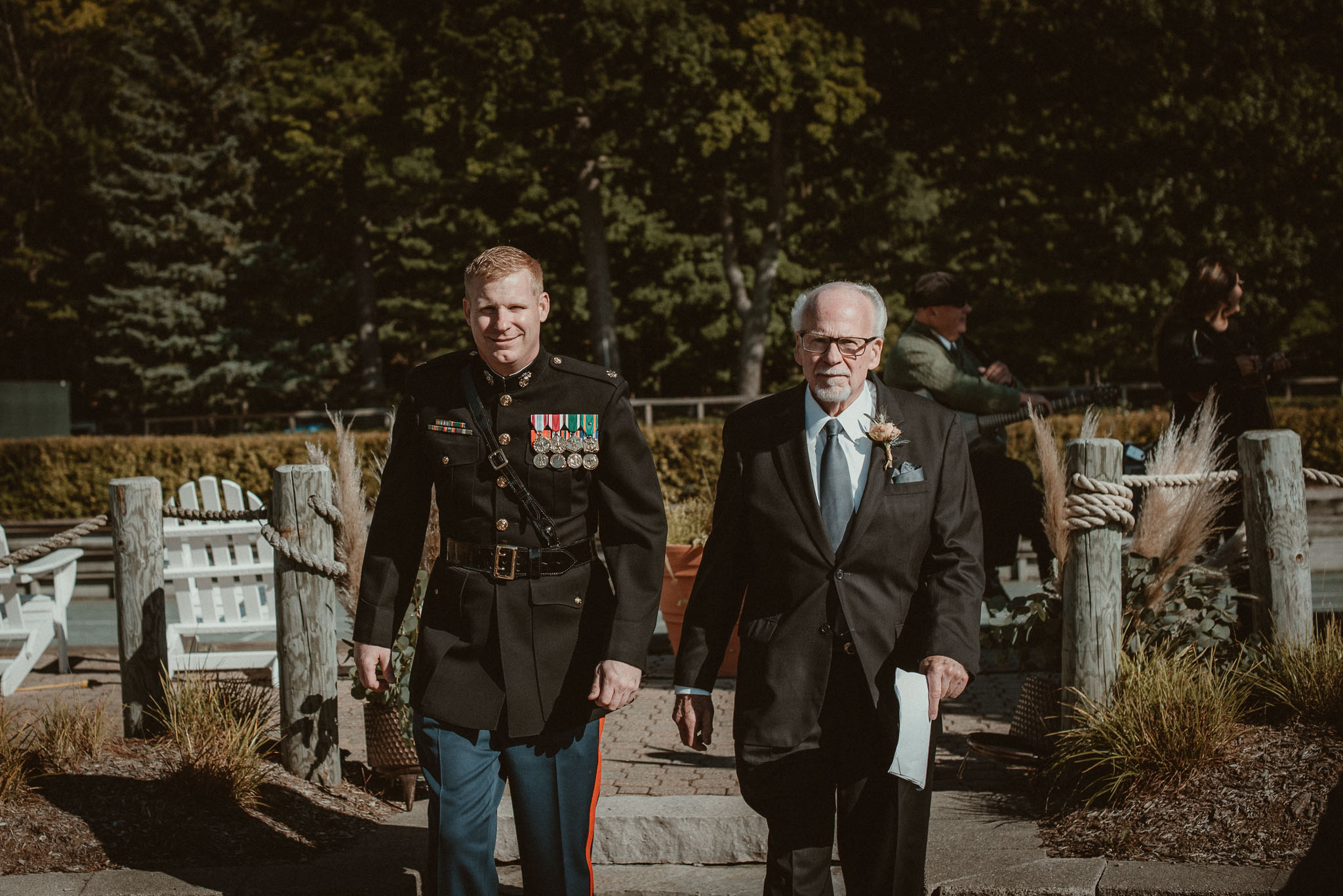 The father of the groom as the officiant walking down the isle with the groom.