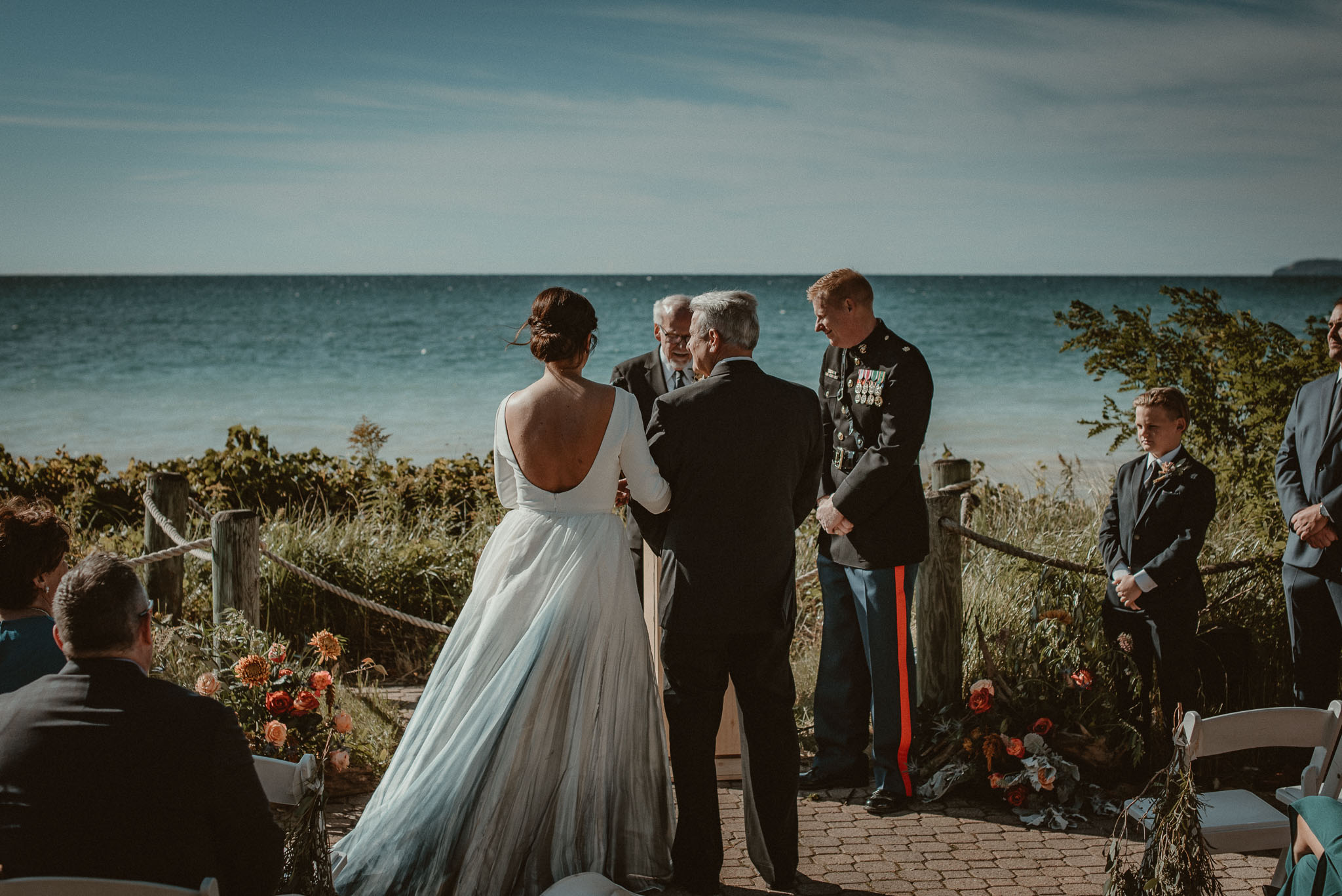 The father of the bride giving her arm to his daughters future husband.