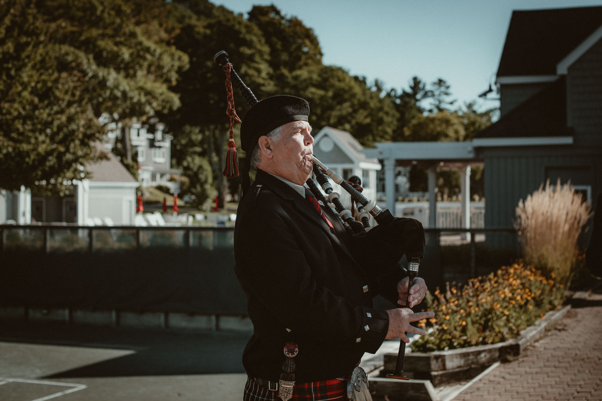Bagpiper performing during the ceremony exit.
