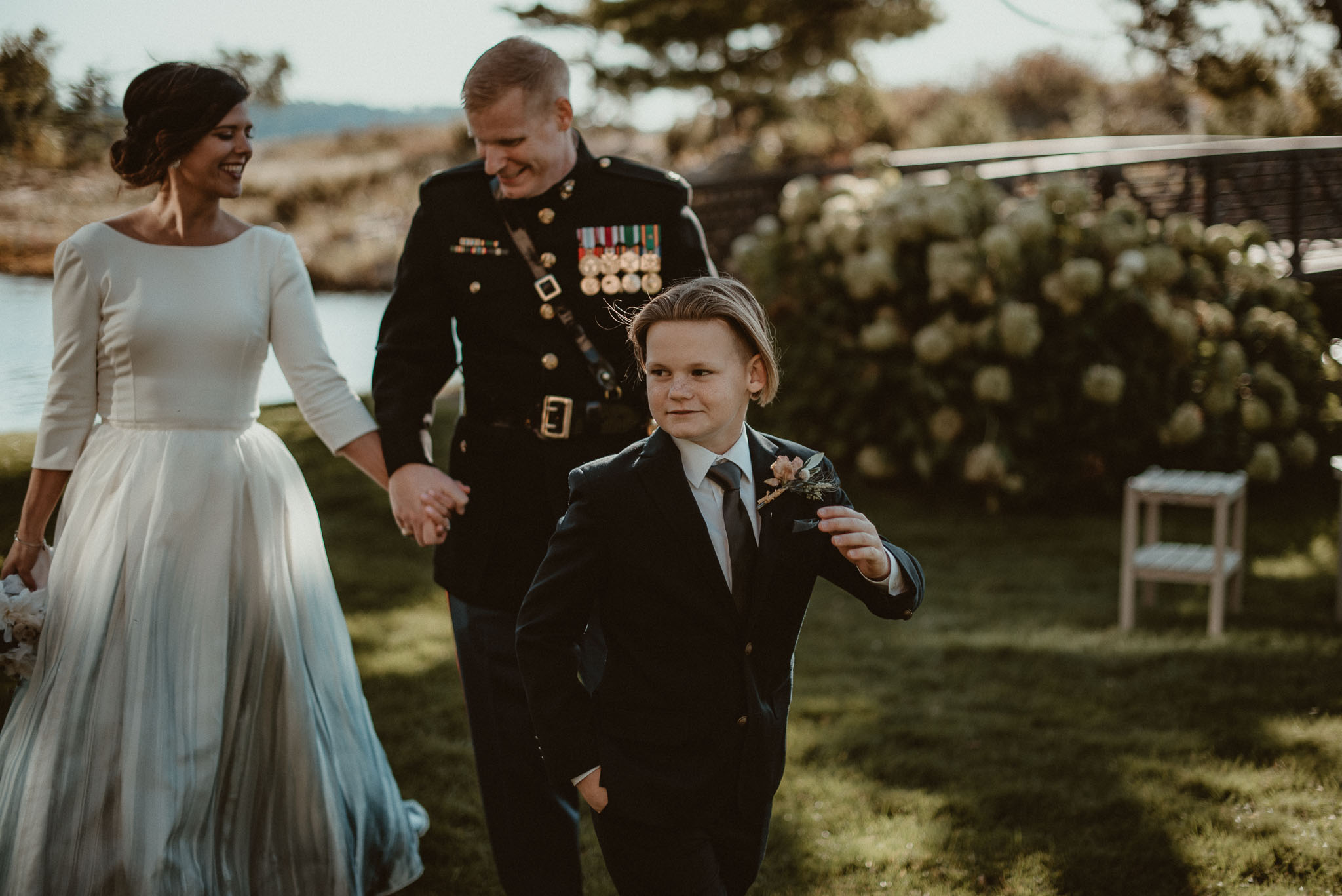 Bride and Groom walking with their son ahead of them.