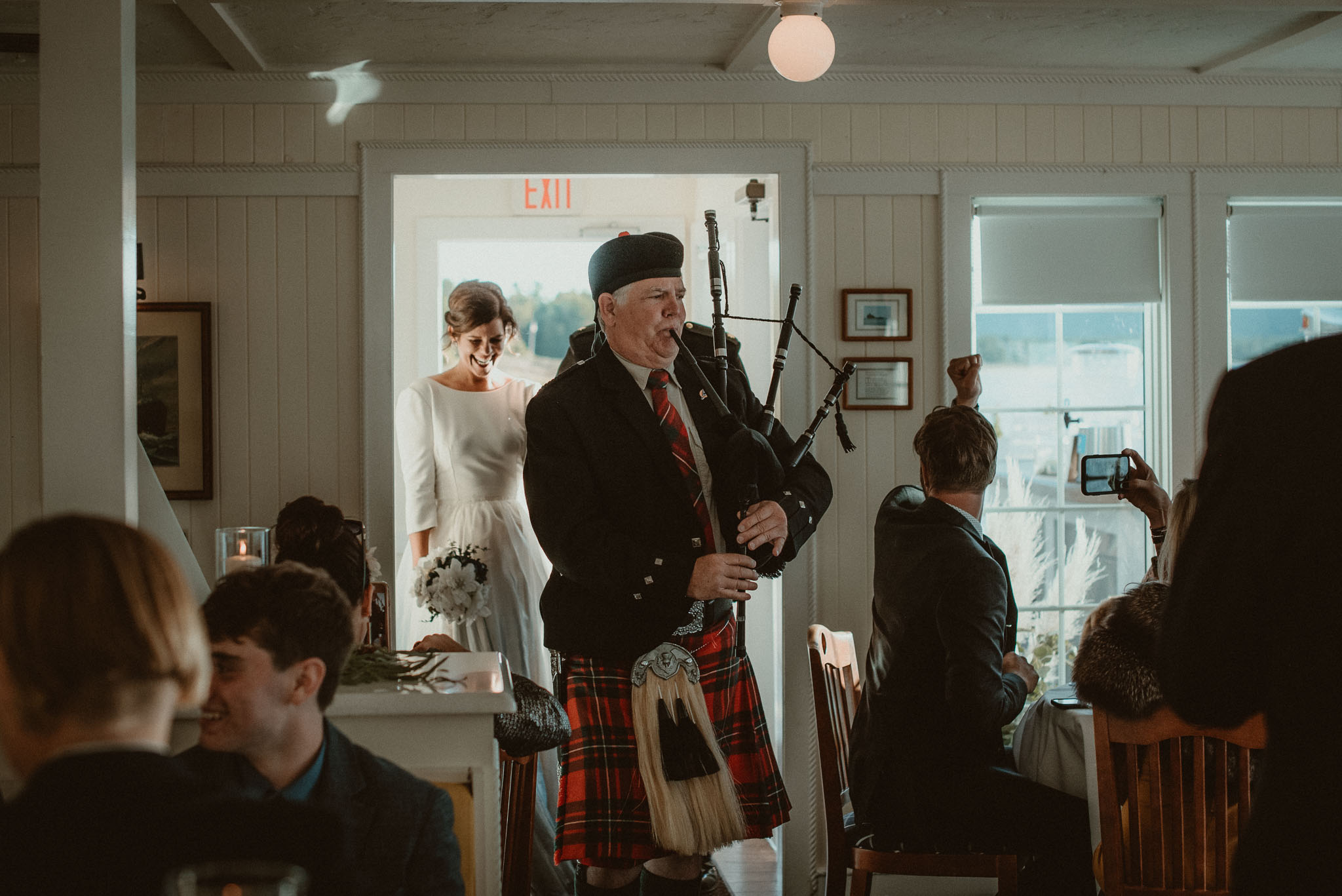 Bagpiper leading the couple into the Cafe Manitou for their grand entrance.
