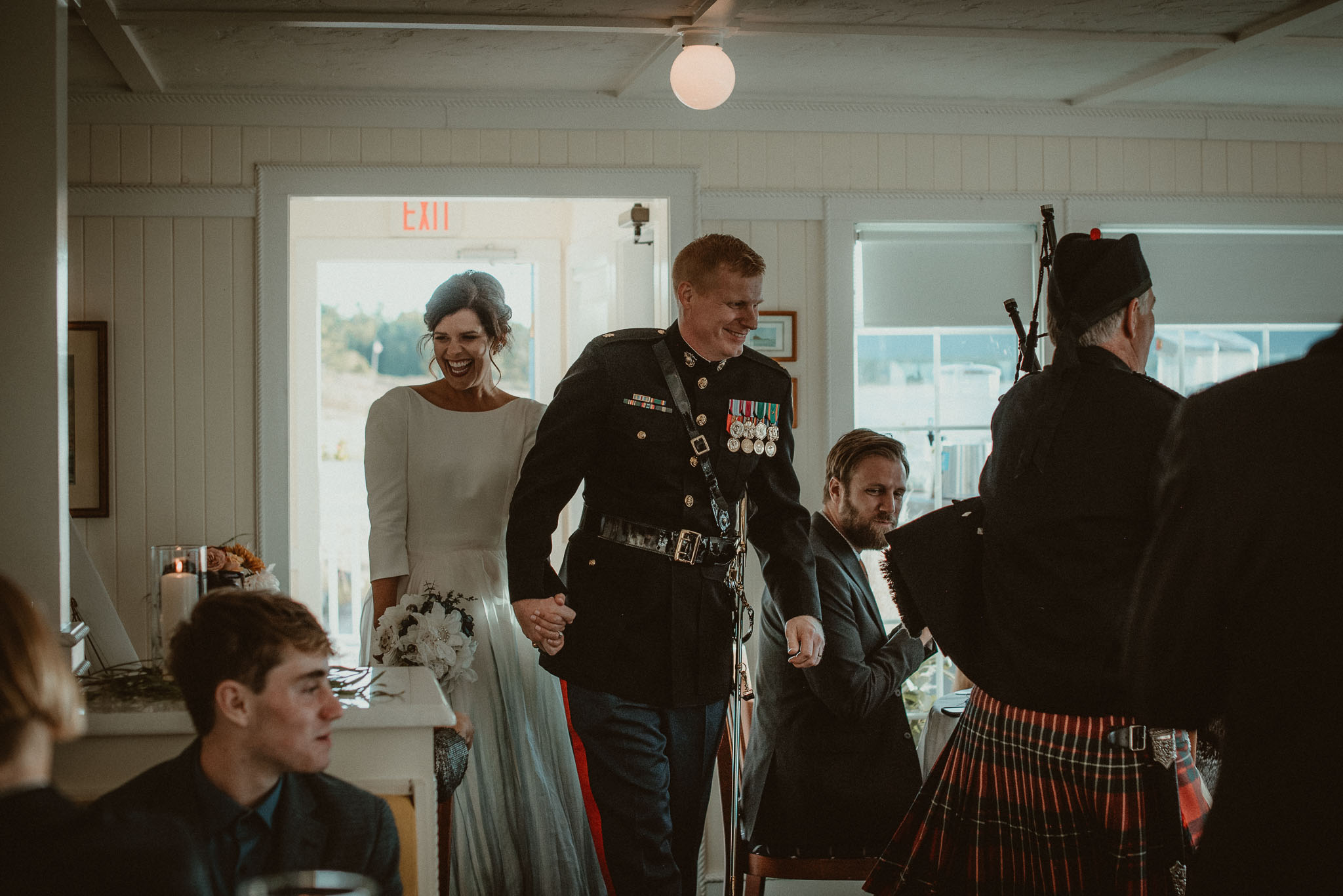 The bride and groom making their grand entrance into Cafe Manitou.