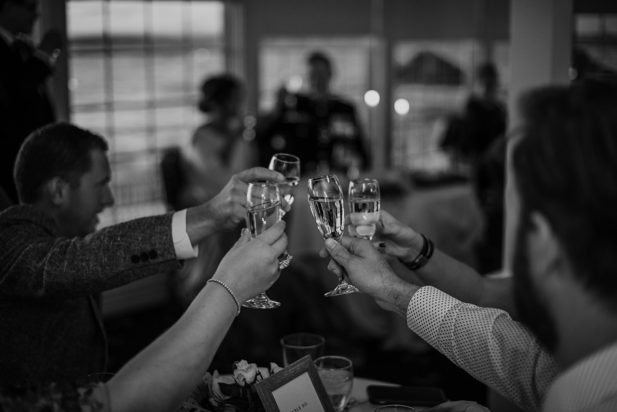Close up of guests champagne glasses in toast