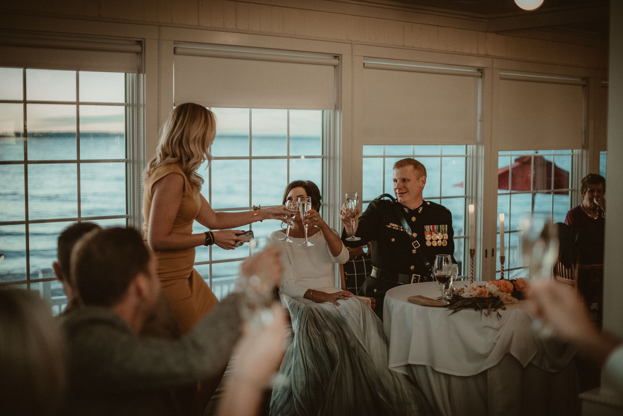 The bride's best friend toasting after giving a hear warming speech.