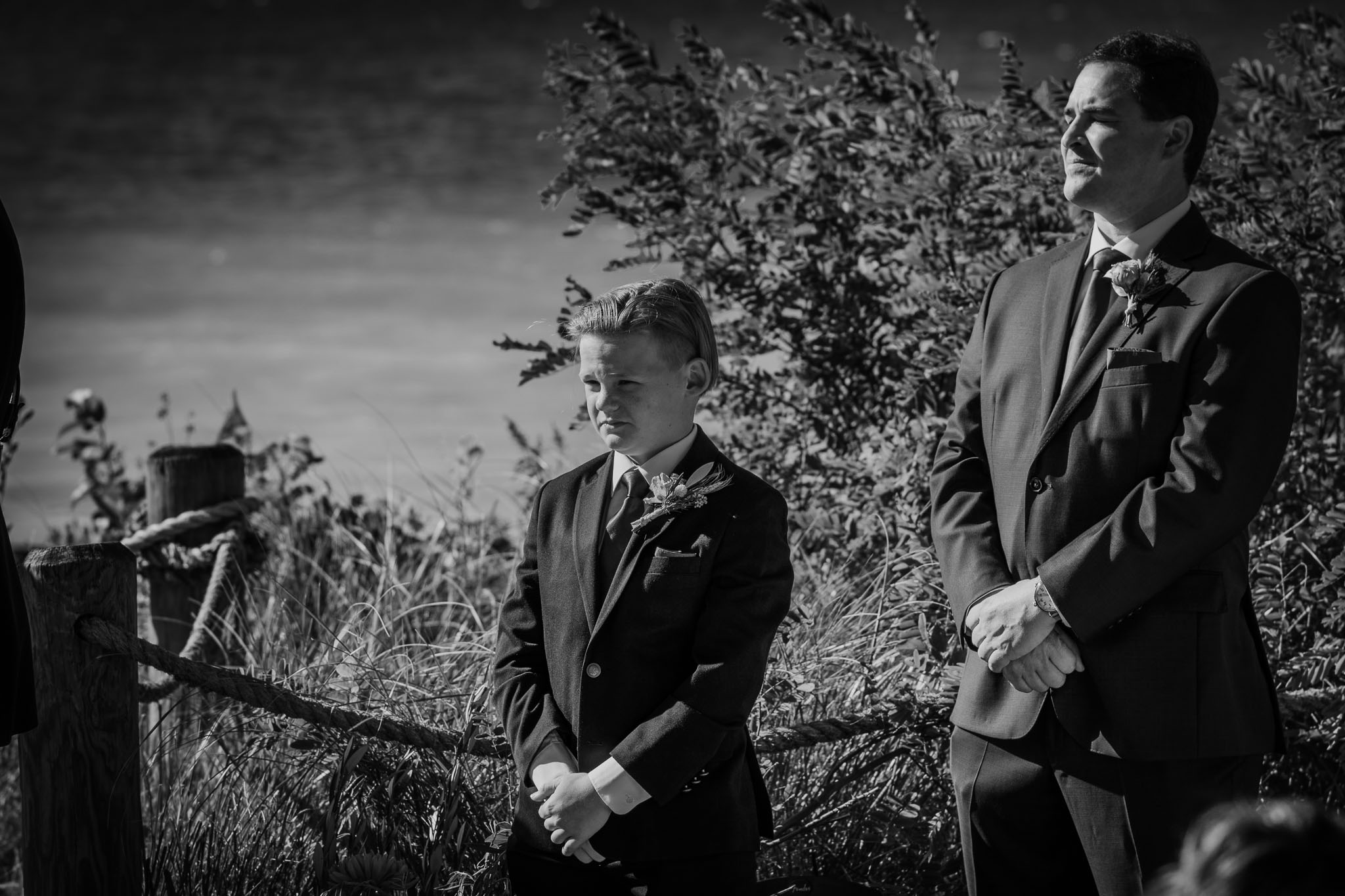 The son of the groom standing up with his dad as marries the love of his life.