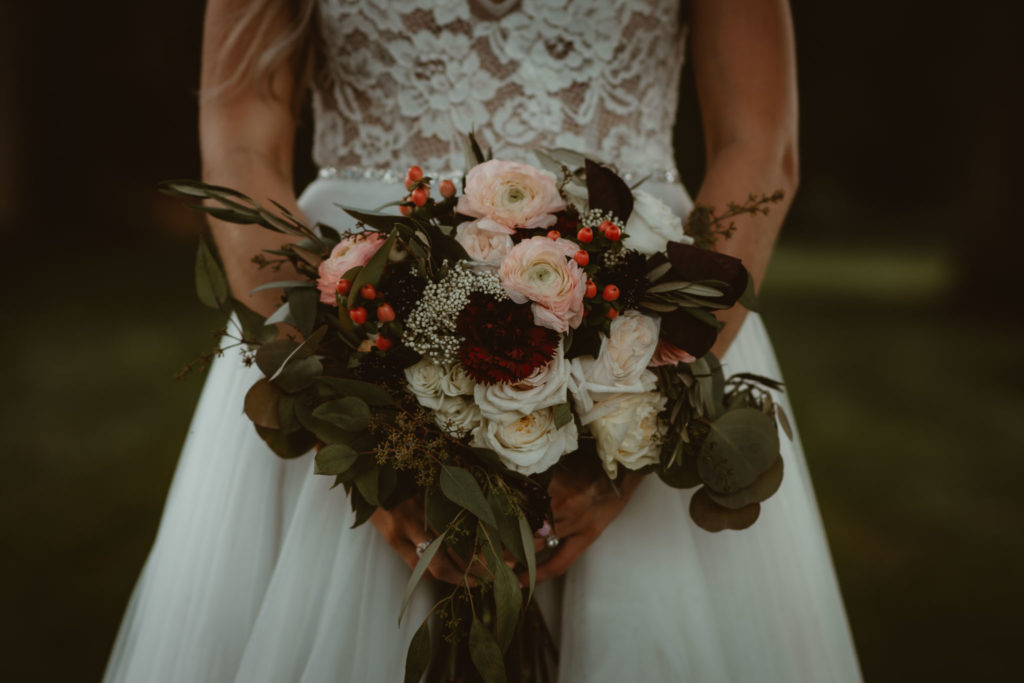 Boho bridal bouquet in the hands of the bride